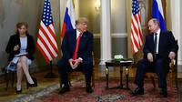 Le président américain Donald Trump rencontre le président russe Vladimir Poutine, le 16 juillet 2018 à Helsinki [Brendan Smialowski / AFP/Archives]