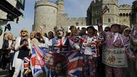Des fans de la famille royale, à Windsor le 18 mai 2018 [Tolga AKMEN / AFP]