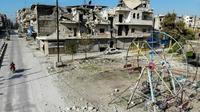 Une photo prise le 22 décembre 2019 montre des immeubles détruits dans la ville de Maaret al-Noomane dans la province d'Idleb, dans le nord-ouest de la Syrie [Omar HAJ KADOUR / AFP]