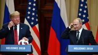 Donald Trump et Vladimir Poutine donnent une conférence de presse à l'issue de leurs pourparlers à Helsinki, le 16 juillet 2018 [Yuri KADOBNOV / AFP]