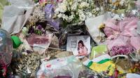 Messages de soutien et fleurs disposés sur la place St Ann à Manchester, en hommage aux victimes de l'attaque terroriste survenue le 22 mai au Manchester Arena