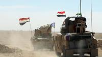 Des troupes irakiennes sur la base militaire de Qayyarah, à soixante km au Sud de Mossoul.