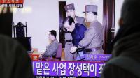 Jang Song-thaek emmené par des gardes à la sortie du tribunal peu avant son éxécution, le 12 décembre 2013.