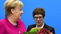 Angela Merkel et Annegret Kramp-Karrenbauer, perçue par beaucoup comme son héritière.