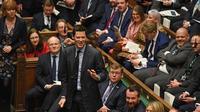 Une photo, publiée par le Parlement britannique, montre des parlementaires à la Chambre des communes dans le centre de Londres le 22 janvier 2020, lors de la session de questions du Premier ministre.