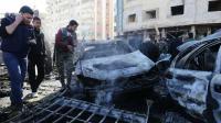 Plusieurs voitures ont pris feu, dans le quartier de Sayeda Zeinab, à la suite de l'explosion.