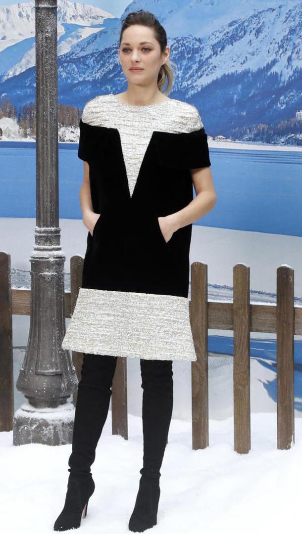 Marion Cotillard, en petite robe blanc et noir, avait également tenu à être présente.