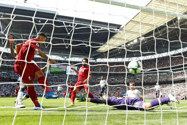 Firmino buteur décisif pour Liverpool lors de la victoire à domicile face au PSG 3-2 en 1re journée de C1 le 18 septembre 2018  [Adrian DENNIS / AFP]