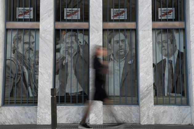 Le portrait de quatre des prévenus (de g à d): Jordi Cuixart, Jordi Sanchez, Oriol Junqueras et Joaquim Forn, le 12 février 2019 à Barcelone [LLUIS GENE / AFP/Archives]