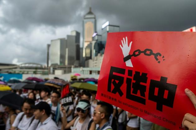 Lors de la marche du 9 juin 2019 à Hong Kong, organisée pour dénoncer un projet du gouvernement local d'autoriser des extraditions vers la Chine continentale [Philip FONG / AFP]