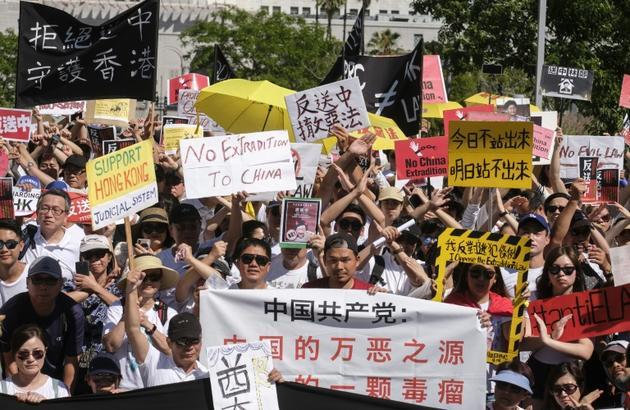 Manifestation contre le projet de loi du gouvernement local d'autoriser les extraditions vers la Chine continentale, le 9 juin 2019 à Hong Kong [RINGO CHIU / AFP]