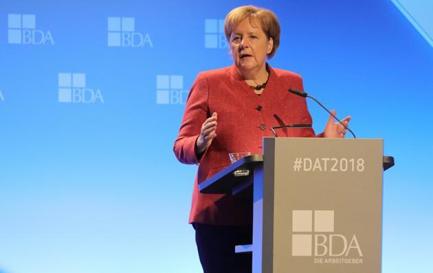 La chancelière Angela Merkel s'exprime devant des entrepreneurs allemands à Berlin, 22 novembre 2018 [Wolfgang Kumm / dpa/AFP]