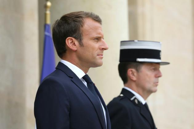 Le président français Emmanuel Macron (G) attend le Premier ministre israélien à l'Elysée le 5 juin 2018 [LUDOVIC MARIN / AFP]