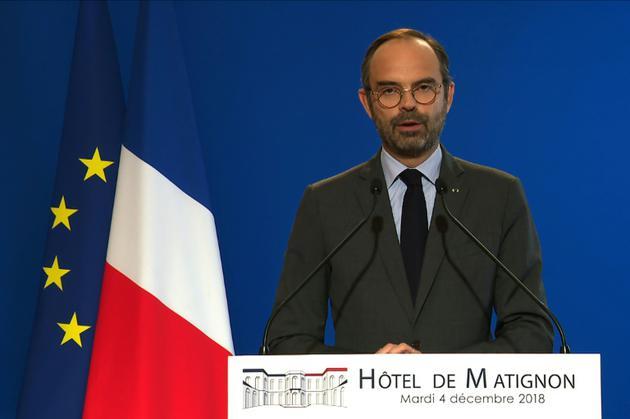 Edouard Philippe annonce la suspension de la hausse de la fiscalité sur les carburants le 4 décembre 2018 à Paris (image AFP TV) [- / AFP/Archives]