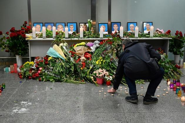 Hommage à l'aéroport de Boryspil près de Kiev le 8 janvier 2020 pour les victimes du crash à Téhéran de l'Ukraine International Airlines  [Sergei SUPINSKY / AFP]