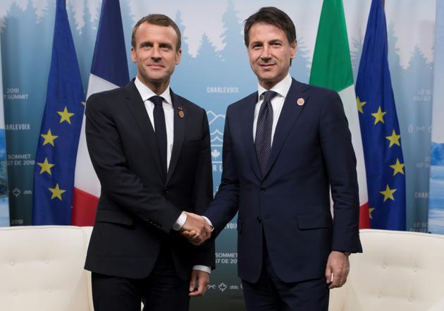 Photo d'archives du président français Emmanuel Macron (gauche)et du chef du gouvernement italien Guiseppe Conte (droite) au sommet du G7 au Canada le 9 juin 2018  [Ian LANGSDON / POOL/AFP/Archives]