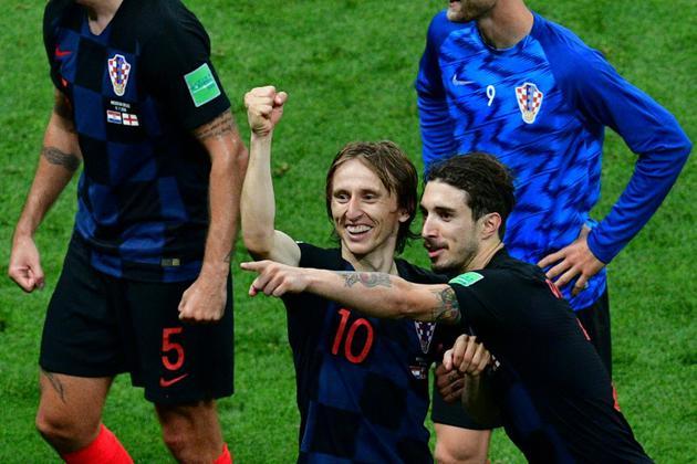 Les Croates Luka Modric (g) et Sime Vrsaljko exultent ils sont en finale du Mondial, le 11 juillet 2018 à Moscou   [Mladen ANTONOV / AFP]