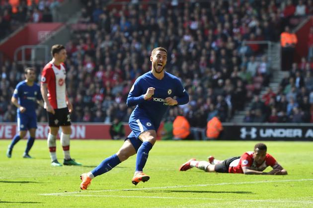 Le milieu belge de Chelsea Eden Hazard exulte après avoir égalisé 2-2 contre Southampton, le 14 avril 2018 à Southampton  [Glyn KIRK                   / AFP/Archives]