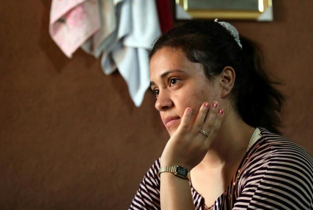Jihane Qassem, une Yazidie de 18 ans, est assise dans un bâtiment abandonné à Baadre, une localité du nord de l'Irak, le 25 juin 2019<br />  [SAFIN HAMED / AFP]