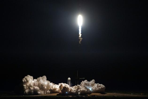 Départ de la fusée Falcon 9 avec la capsule Crew Dragon depuis le centre spatial Kennedy, le 2 mars 2019 [Jim WATSON / AFP]