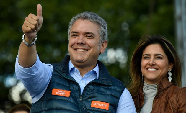 Le candidat de la droite à la présidentielle Ivan Duque lors d'un meeting de campagne, le 20 mai 2018 à Bogota [Raul ARBOLEDA / AFP/Archives]