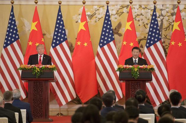 Les présidents américain Donald Trump et chinois Xi Jinping à Pékin le 9 novembre 2017. [Nicolas ASFOURI / AFP/Archives]