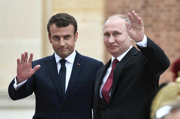 Emmanuel Macron et le président russe Vladimir Poutine à Versailles, près de Paris, le 29 mai 2017 [STEPHANE DE SAKUTIN / AFP/Archives]