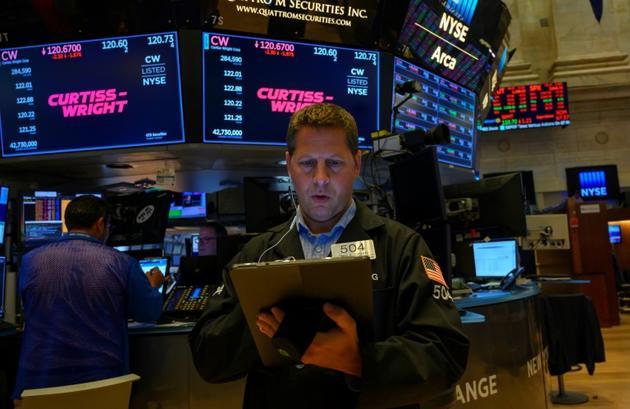 Des traders à la Bourse de New York, le 23 août 2019 [Don Emmert / AFP]