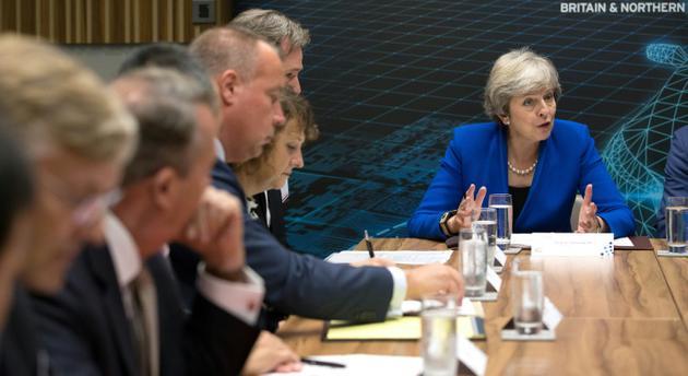 La Première ministre britannique Theresa May parle à des entrepreneurs à Birmingham (centre de l'Angleterre) le 11 septembre 2018. [Aaron Chown / POOL/AFP]