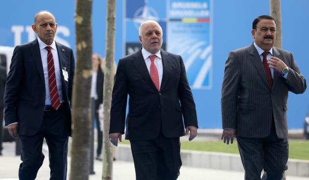 Le Premier ministre irakien Haider al-Abadi (C) à Bruxelles où il a participé à une réunion sur la lutte antijihadistes, le 12 juillet 2018 [LUDOVIC MARIN / AFP]