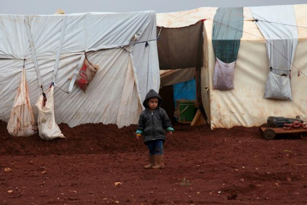 Un enfant syrien dans un camp de réfugiés dans la province d'Idleb, au nord-ouest de la Syrie, le 25 octobre 2018<br /> [Amer ALHAMWE / AFP]