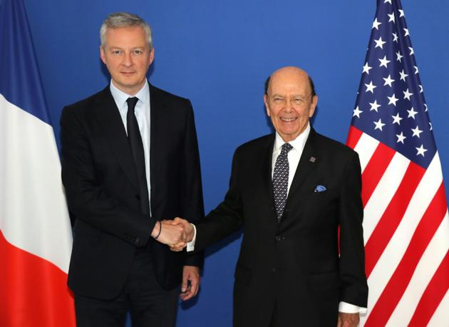 Le ministre français de l'Economie Bruno Le Maire (G) en compagnie du secrétaire américain au Commerce Wilbur Ross (D), le 31 mai 2018, au ministère des Finances à Paris [JACQUES DEMARTHON / AFP]