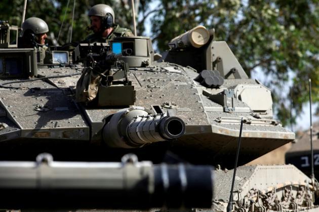 Des soldats israéliens manoeuvrent un char sur le plateau du Golan annexé par l'Etat hébreu, le 2 juin 2019 [JALAA MAREY / AFP]