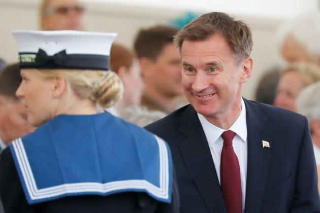 Jeremy Hunt (d), ministre britannique des Affaires étrangères, le 5 juin 2019 à Portsmouth (Royaume-Uni) [Tolga AKMEN / AFP/Archives]
