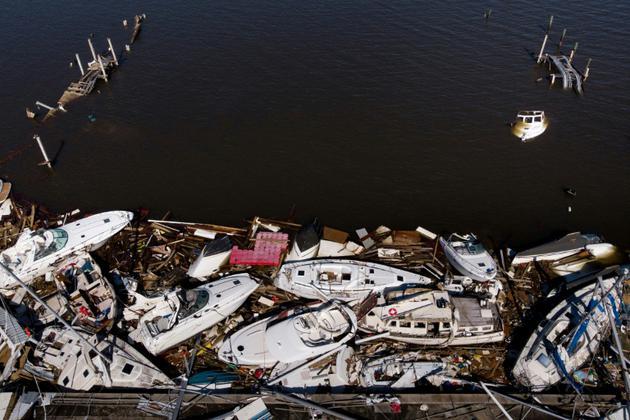 Vue aérienne de bateaux endommagés après le passage de l'ouragan Michael le 11 octobre 2018 à Panama city. [Brendan Smialowski / AFP]
