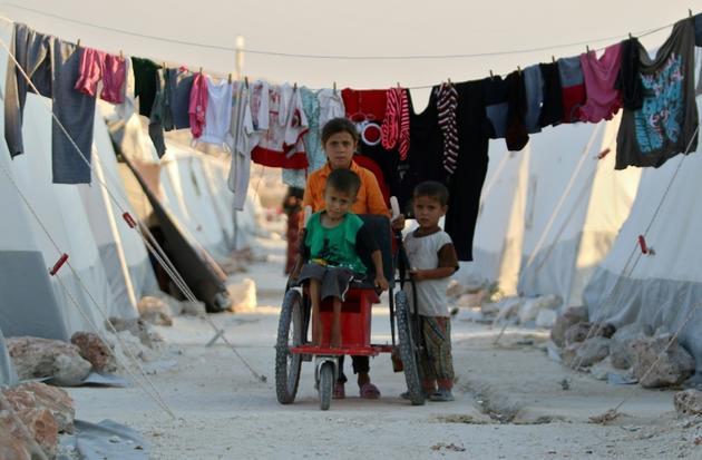 Des enfants dans un camp de déplacés dans la province syrienne d'Idleb, près de la frontière turque, le 26 août 2018 [Aaref WATAD / AFP]
