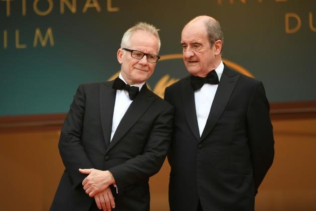 Le délégué général du Festival de Cannes Thierry Frémaux et le président du Festival Pierre Lescure, le 18 mai 2018 [LOIC VENANCE / AFP]