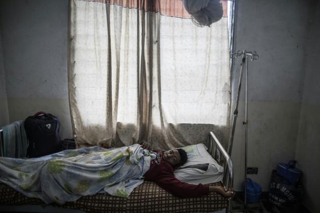 Ronaldo Mbuh sur son lit d'hôpital à Buea, le 4 octobre 2018 [MARCO LONGARI / AFP]