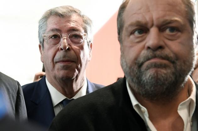 Patrick Balkany derrière son avocat Eric Dupond-Moretti, à Paris, le 13 mai 2019 [Bertrand GUAY / AFP/Archives]