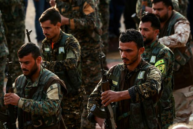 Des combattants kurdes des Unités de protection du peuple (YPG) à Qamishli, en Syrie, le 6 décembre 2018 [Delil SOULEIMAN / AFP/Archives]