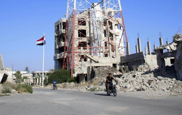Vue sur le secteur du centre de Deraa tenu par les rebelles mais où sont entrées les forces du régime syrien le 12 juillet 2018 [Mohamad ABAZEED / AFP]