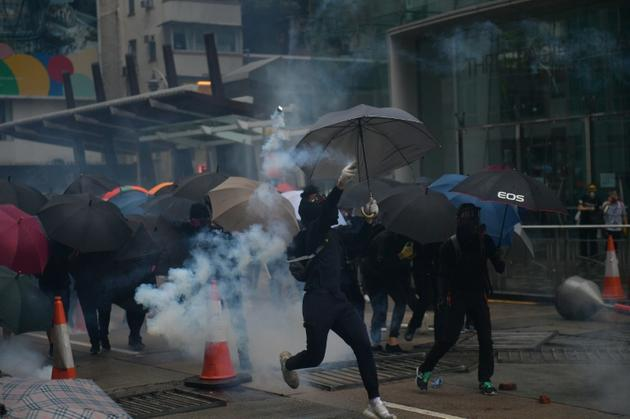 Hong Kong police fired tear gas at pro-democracy protesters after tens of thousands hit the streets once more [Nicolas ASFOURI / AFP]