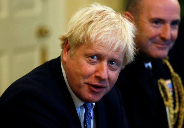 Le Premier ministre Boris Johnson lors d'une table ronde avec des chefs militaires à Downing Street à Londres, le 19 septembre 2019 [HENRY NICHOLLS / POOL/AFP]