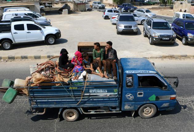 Des Syriens fuient les bombardements du régime dans la province d'Idleb le 9 septembre 2018 [Aaref WATAD / AFP]