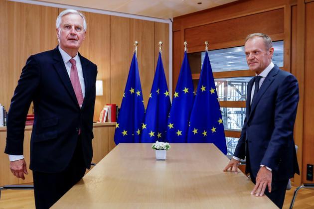 Michel Barnier, négociateur du Brexit pour l'Union Européenne, et Donald Tusk, président du Conseil Européen, le 16 octobre 2018 à Bruxelles [OLIVIER HOSLET / POOL/AFP]