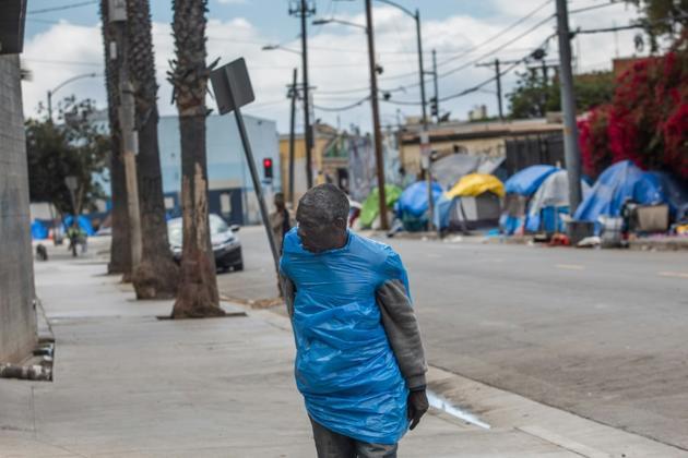 Des sans-abri à Los Angeles, le 19 mars 2020 [Apu GOMES / AFP]