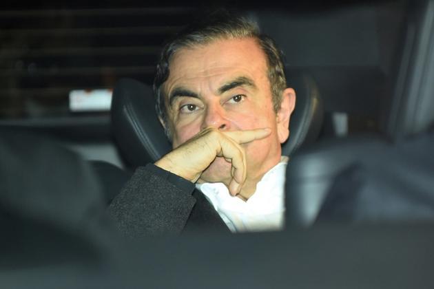 L'ancien patron de Renault Carlos Ghosn quitte les bureaux de ses avocats peu après sa sortie de prison, le 6 mars 2019 à Tokyo [Kazuhiro NOGI / AFP]