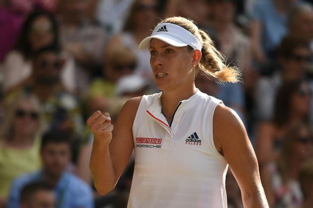L'Allemande Angelique Kerber  vainqueur du tournoi de Wimbledon face àSerena Williams le 14 juillet 2018 [Oli SCARFF                           / AFP]