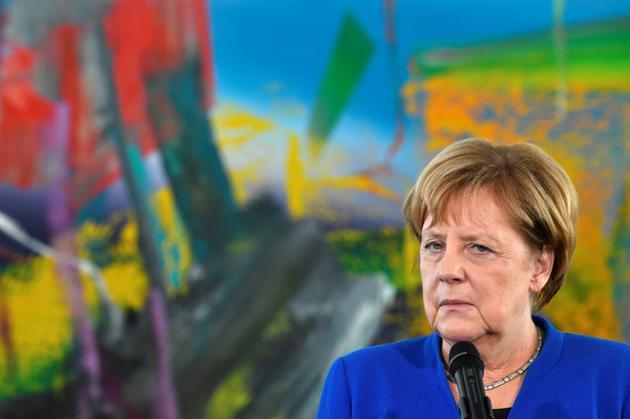 La chancelière allemande Angela Merkel, ici à Berlin le 11 octobre 2018, est en difficulté sur le plan politique depuis qu'elle a ouvert les frontières à plus d'un million de migrants en 2015 [John MACDOUGALL / AFP/Archives]