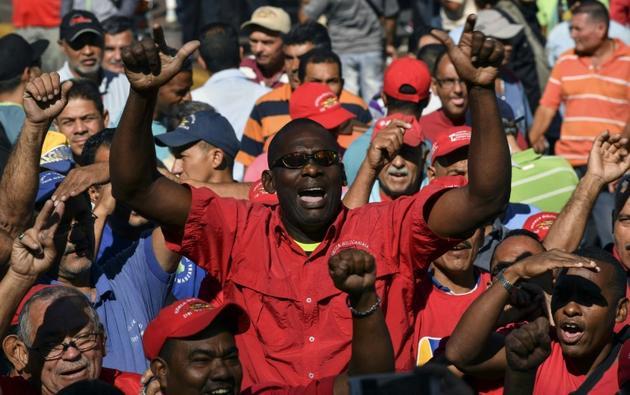 Des partisans de l'opposant vénézuélien Juan Guaido lors d'un rassemblement, le 20 février 2019 à Caracas [YURI CORTEZ / AFP]